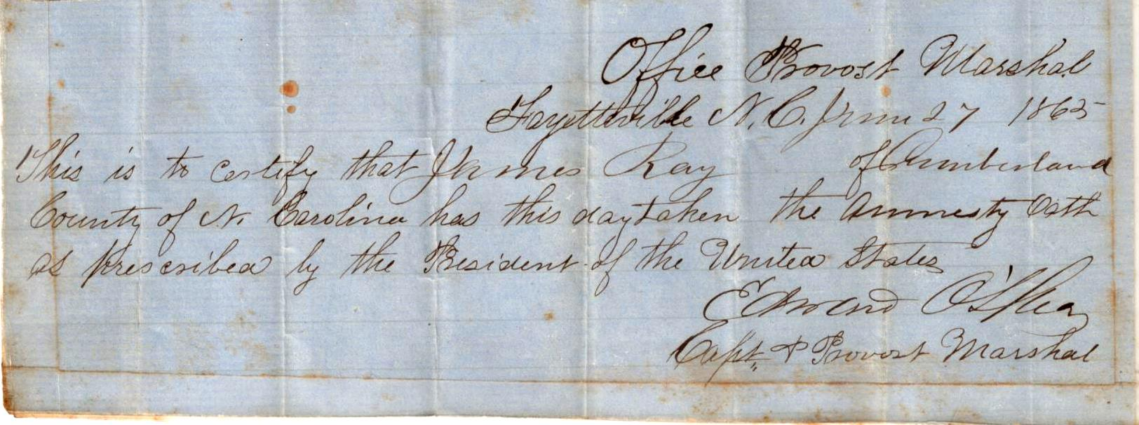 """A rectangular slip of paper upon which is written """"Office Provost Marshal Fayetteville NC June 27 1863 This is to certify that James Ray of Cumberland County has this day taken the amnesty oath as prescribed by the President of the United States. Edward O'Shea Capt & Provost Marshal"""