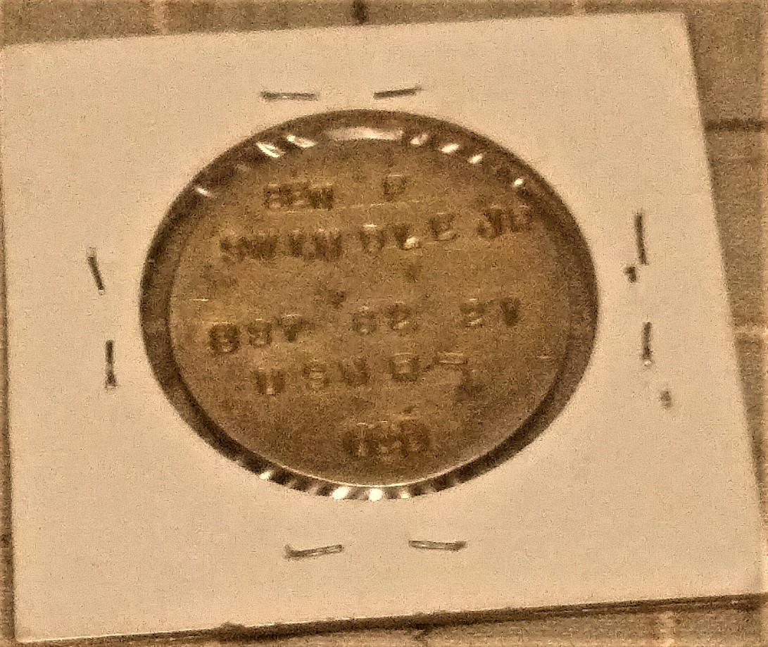 Reverse of 1911-1936 Australian Florin that has been made into a US service members's Dog tag