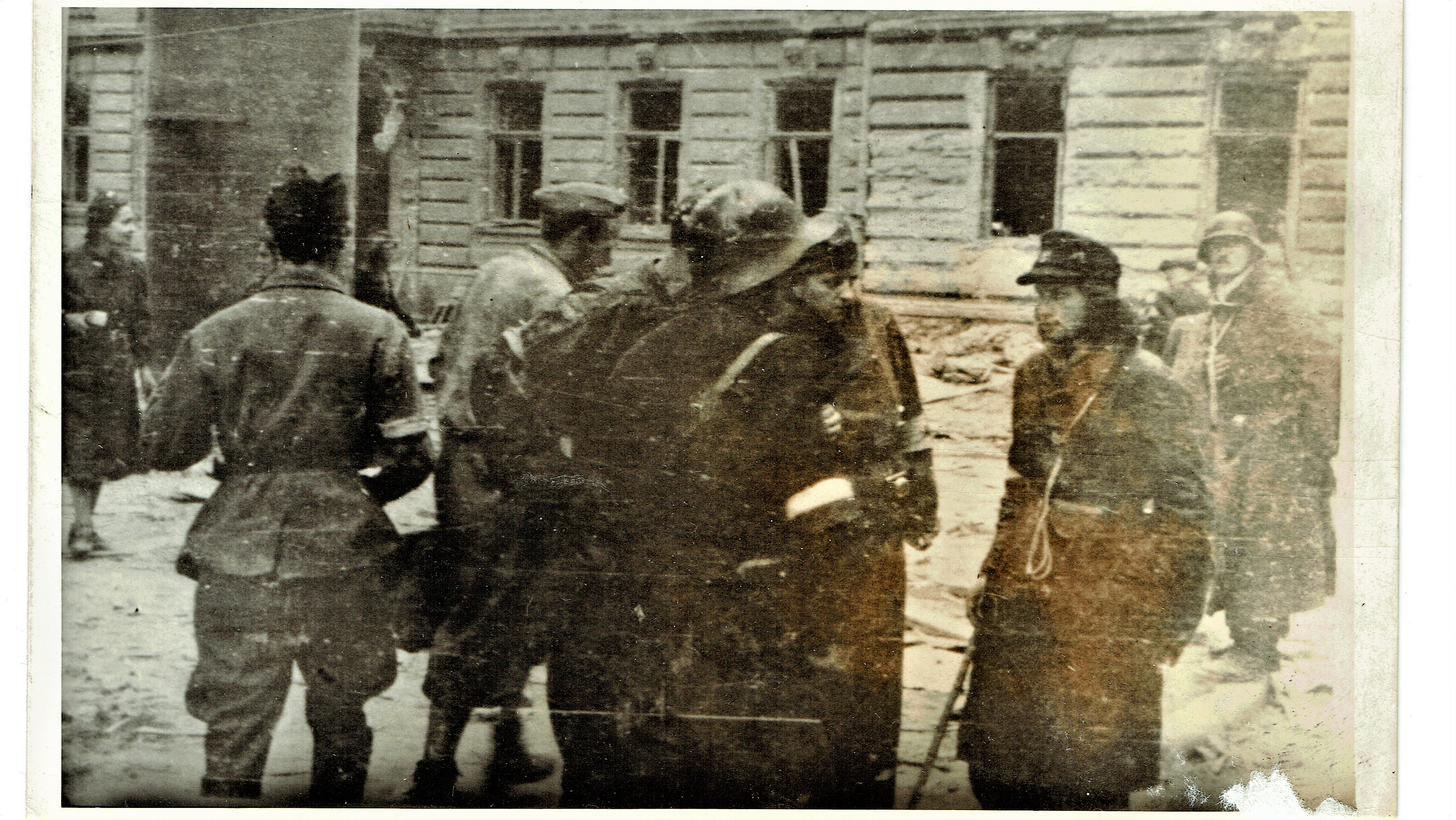 WWII soldiers in discussion on street