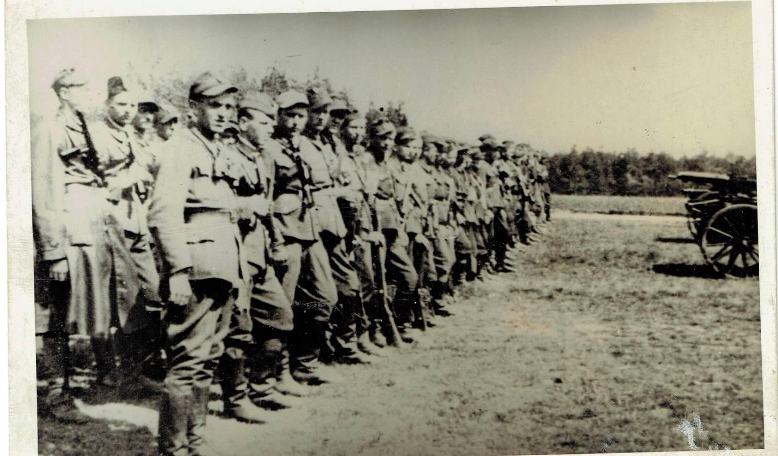 WWII soldiers standing in line on field