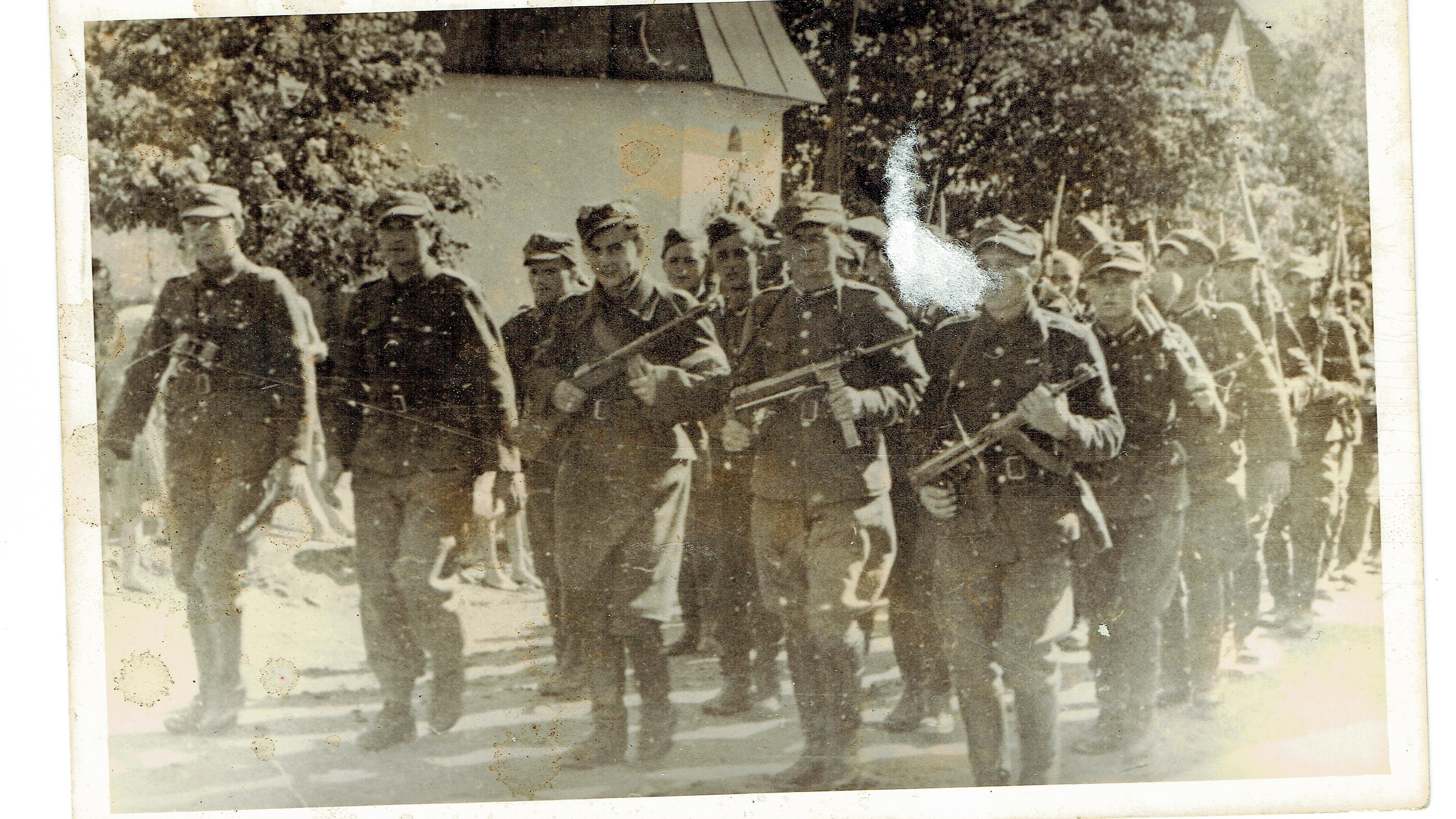 WWII soldiers marching with guns