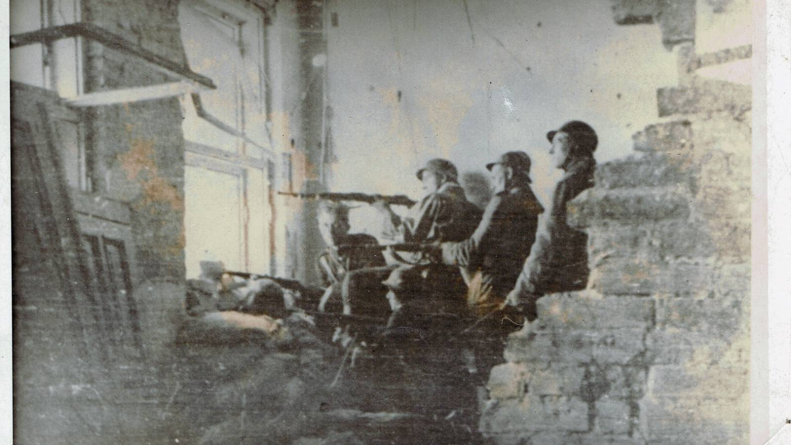 WWII picture - soldiers shooting from inside building