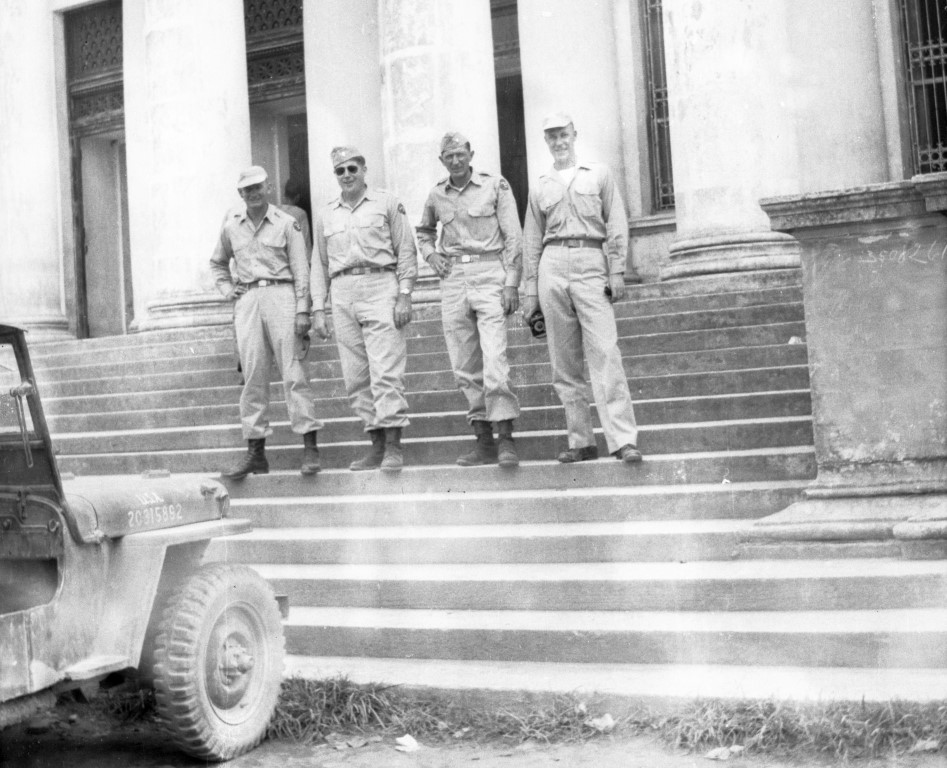 four soldiers on steps of build in Manila (Oct 1945 - Mar 1946)