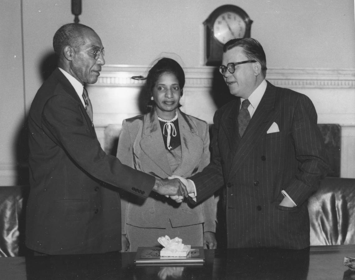 64-NA-1-142 Dr. Grover Congratulates Hiram O. Caldwell Upon His Retirement, Nov. 30, 1951.jpg