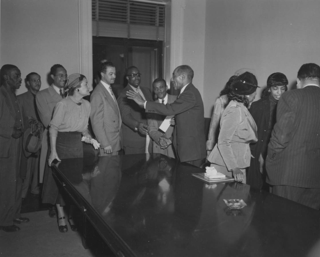 64-NA-1-143 Well Wishers Greet Hiram O. Caldwell at His Retirement Ceremony, Nov. 30, 1951.jpg