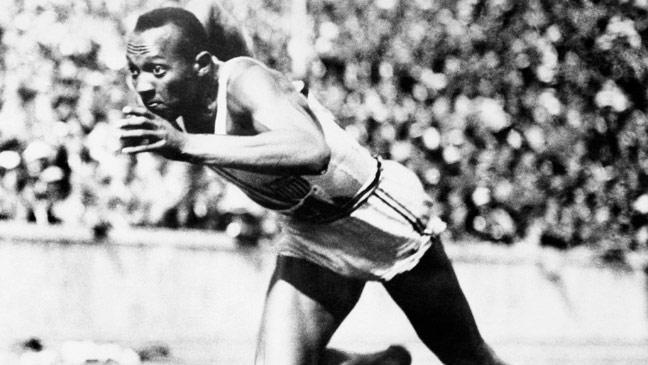 jesse-owens-breaks-the-100m-tape-to-win-the-first-of-his-four-gold-medals-at-the-berlin-olympics-136399538907703901-150731164307.jpg