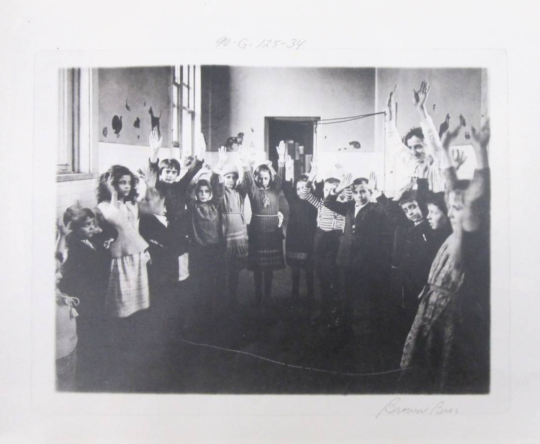 90-G-125-34 Kids Raising Hands at Ellis Island - Photostat.jpg